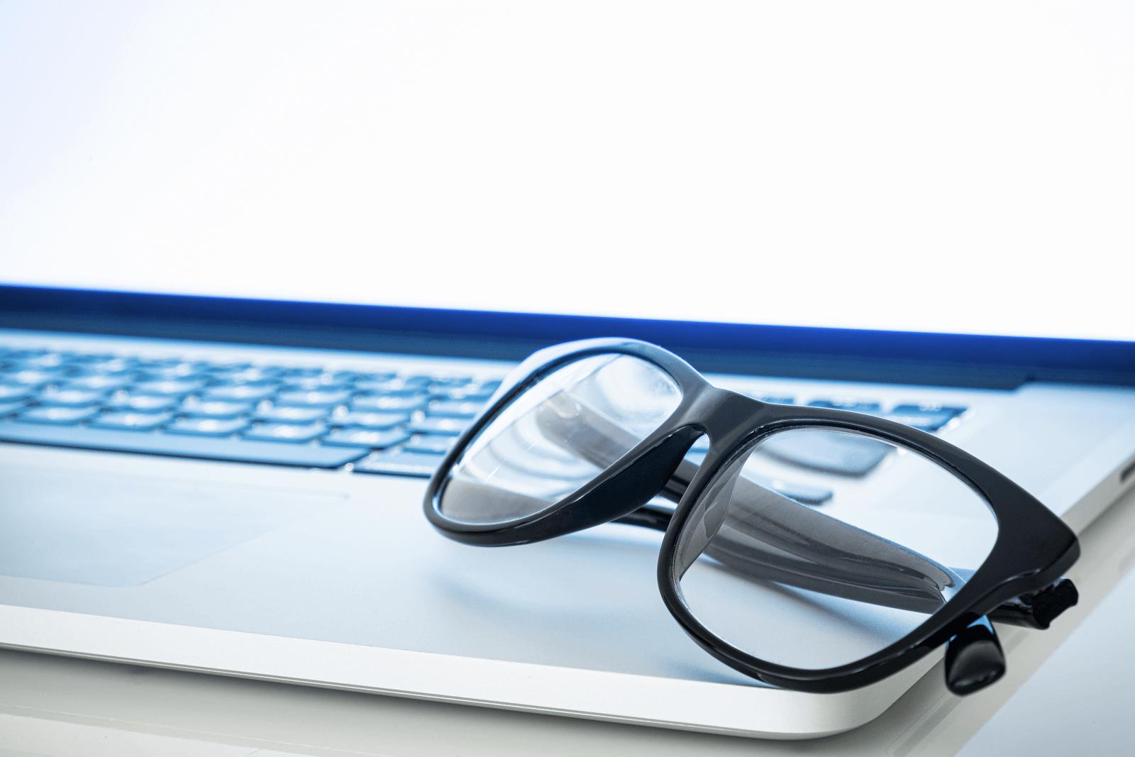 sleep efficiency: eyeglasses on laptop
