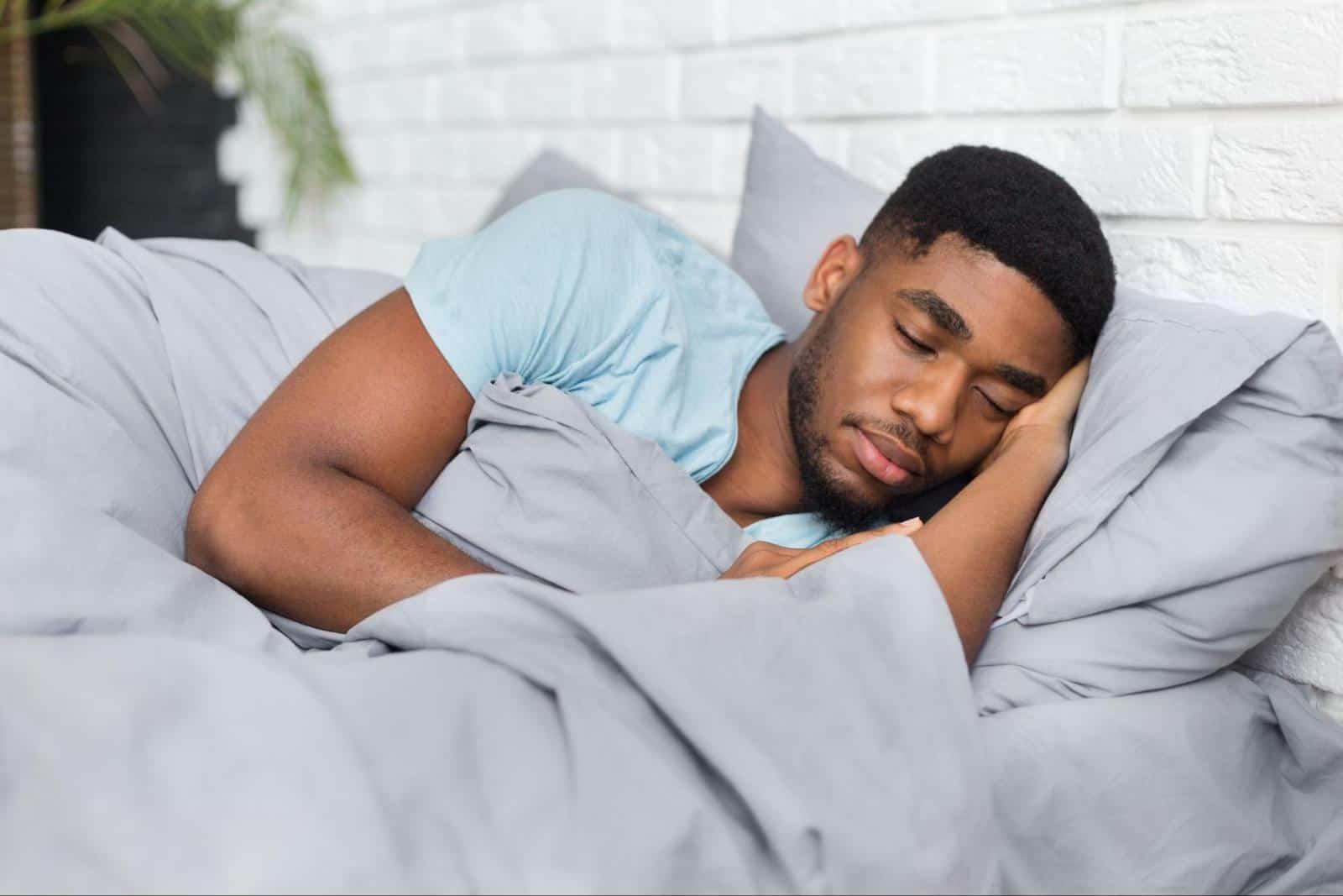 poor sleep hygiene: man sleeping