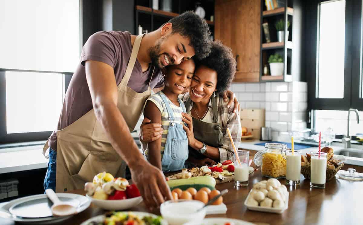 Happy family preparing healthy food